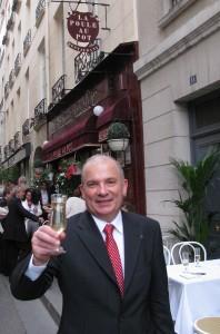 Paul Racat raises a glass to traditional bistro fare at La Poule au Pot. Photo GLK.